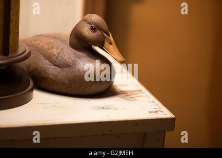 Duck hunting decoy displayed on a table - Stock Photo