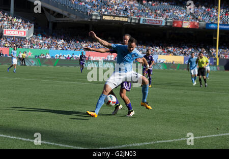 New York, NY USA - May 29, 2016: RJ Allen (27) of NYC FC & Adrian Winter (32) of Orlando City SC fight for ball during MLS match on Yankee stadium