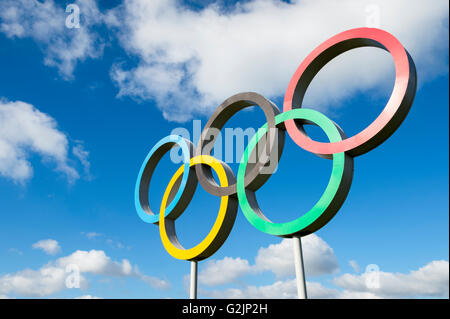 LONDON, UK - OCTOBER 14, 2015: Olympic rings stand under bright blue sky in the Queen Elizabeth Olympic Park. - Stock Photo