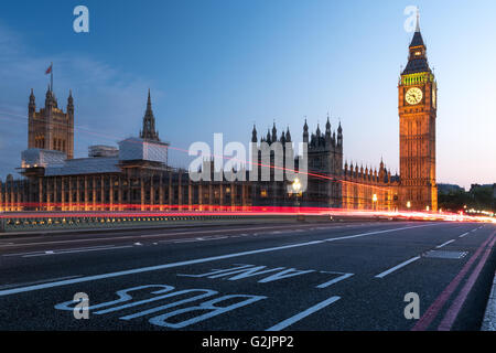 Houses of Parliament, Big Ben and Westminster Bridge in London at night - Stock Photo
