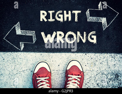 Student standing above the wrong and right sign,dilemma concept - Stock Photo