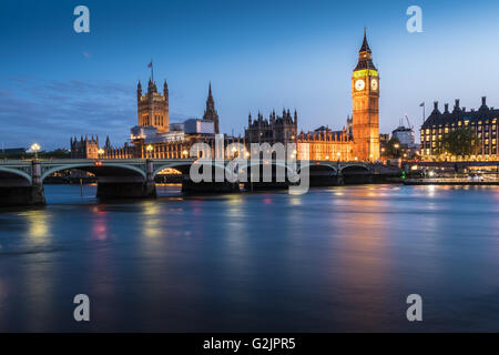 The Houses of Parliament, Elizabeth Tower, Big Ben and the River Thames in London, England at dusk - Stock Photo