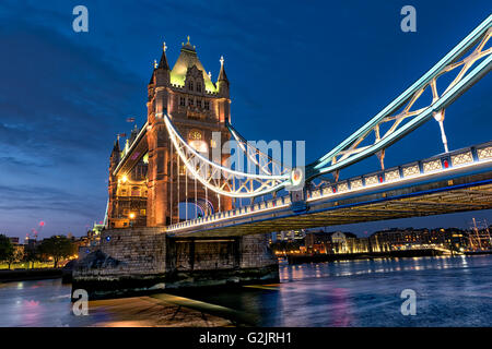 Tower Bridge over the River Thames in London at sunset - Stock Photo