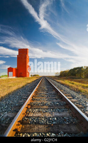 old grain elevator and railway tracks, Carey, Manitoba, Canada - Stock Photo