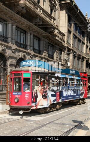 Old and vintage tram on the street of Milan, Italy - Stock Photo