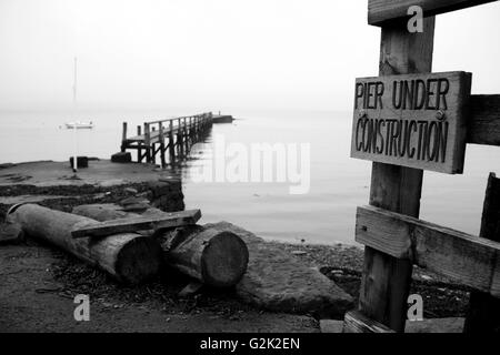 wooden Pier under construction - Stock Photo