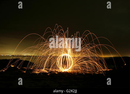 LIght Display at NIght on Black Sands, Aberdour, Fife Scotland - Stock Photo