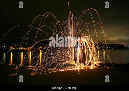 Light Display at night on Black sands, Aberdour, Fife, Scotland - Stock Photo