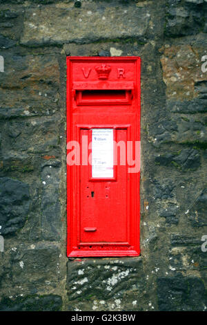 Red Victorian post box set in wall - Stock Photo