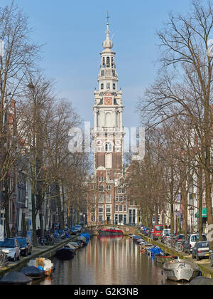 Amsterdam, Netherlands – March 10, 2016: Canal and houses in Amsterdam, with blue skies in the background - Stock Photo