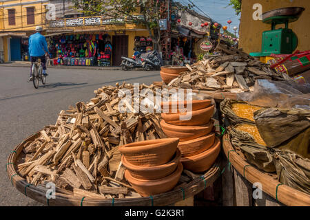 Naturally fragant wood for sale (probably aloeswood) for burning as incense, Hoi An, Vietnam - Stock Photo