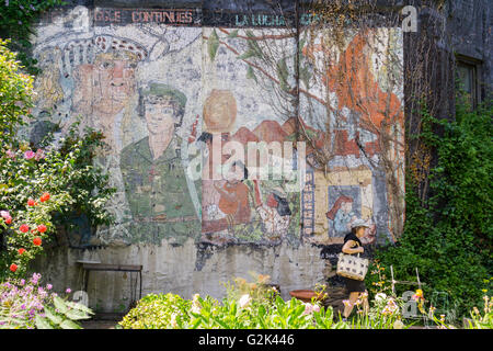 Visitors Pass A Distressed Mural From 1985 In La Plaza Cultural Stock Photo Royalty Free Image