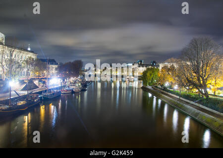 Nightview of Seine river in paris - Stock Photo
