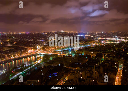 Aerial Night view of Paris City and Seine river shot on the top of Eiffel Tower - Stock Photo