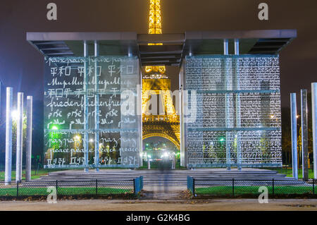 PARIS,FRANCE-NOVEMBER 16:  The Eiffel Tower at Dusk looking through the Mur de la Paix Wall for Peaceon the 16 november - Stock Photo