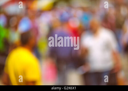 Street crowd out of focus, unrecognizable everyday ordinary men and women as blur urban background. - Stock Photo