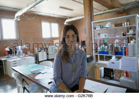 Portrait confident female designer in office - Stock Photo