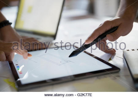Close up designers drawing on digital tablet - Stock Photo