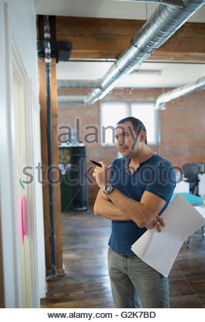Creative businessman brainstorming in office - Stock Photo