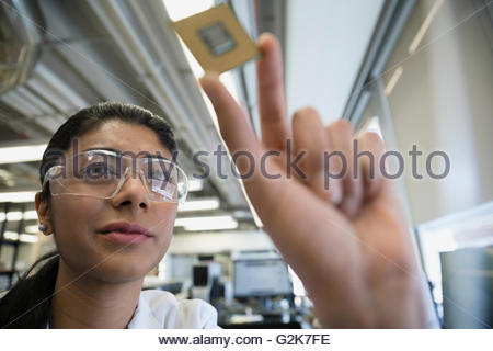 Engineer examining computer chip - Stock Photo