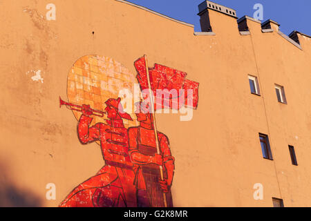 Soviet style painting on the wall of old residential building in St. Petersburg, Russia - Stock Photo