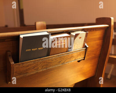 Prayer books on a bench in a synagogue, Toronto, Ontario Province, Canada - Stock Photo