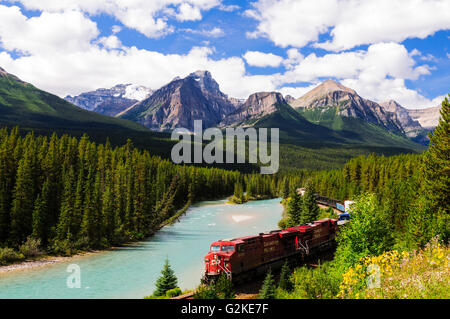 A Canadian Pacific freight train at Morant's Curve along the Bow River on the Bow Valley Parkway near Banff, Alberta - Stock Photo
