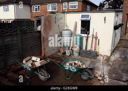 HARD LANDSCAPING UNDERWAY IN A RURAL BACK GARDEN. UK - Stock Photo