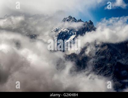 Nepal, Annapurna, Muktinath, Nilgiri Himal and clouds - Stock Photo
