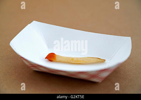 Last french fry in takeout container - Stock Photo