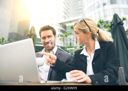 Business people meeting for a coffee break - Stock Photo