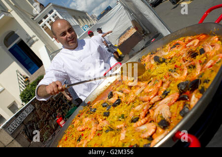 A large Paella being cooked during a seaside festival,Jersey,Channel Islands - Stock Photo