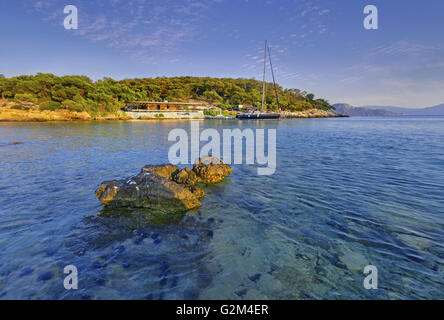 Close view to Aponissos cove, on Agistri island found in the Saronic Gulf, one hour voyage from Piraeus, the main - Stock Photo