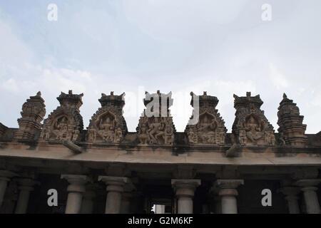 Carved figures at the top of the entrance porch, Gomateshwara temple, Vindhyagiri Hill, Shravanbelgola, Karnataka, - Stock Photo