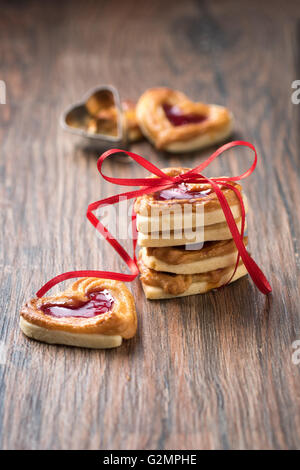 Fresh cookies with a bow on a wooden table. Use it for a card or recipe. - Stock Photo