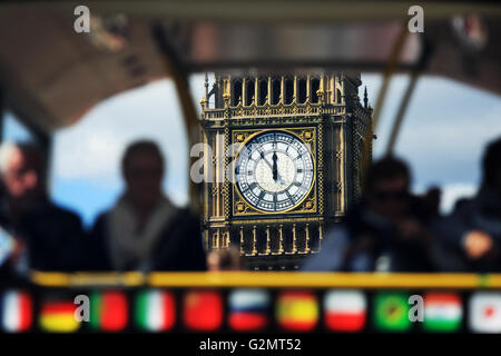 A view of one of the clock faces on The Elizabeth Tower, viewed through a tour bus on Westminster Bridge in London, - Stock Photo