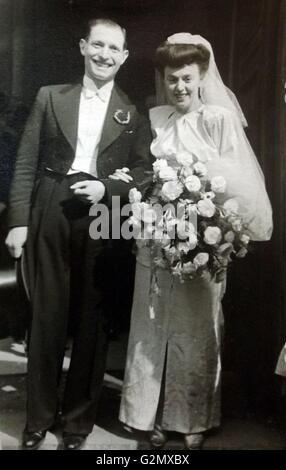 1947 Post-war wedding in England. - Stock Photo