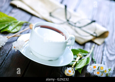 tea in cup and on a table - Stock Photo