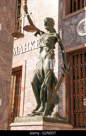 Lady of Justice statue holding the balance & the sword - Stock Photo
