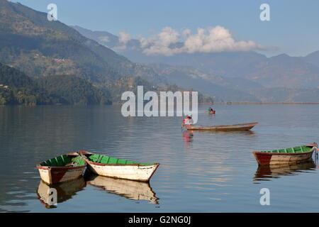 Colourful rowing boats on the Phewa Lake, Pokhara, Nepal - Stock Photo