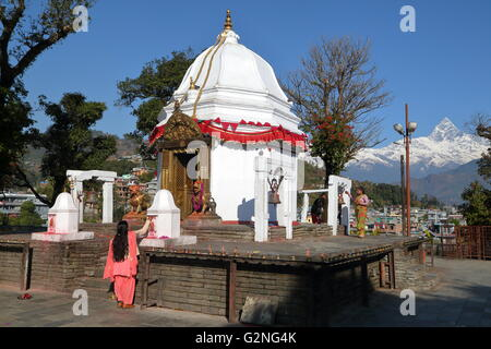 Bindhya Basini Temple in Pokhara, Nepal, the Himalaya mountains with Machapuchare Peak in background - Stock Photo