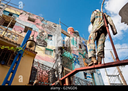 A view of the artwork in Hamel's Alley in Havana, Cuba using scrap metal and paint. - Stock Photo