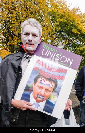 20/10/2012, Belfast - Man dressed as a vampire holding photo of David Cameron. ICTU hold an anti-austerity rally - Stock Photo