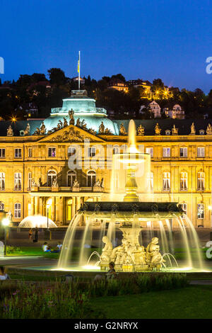 Fountain at neues Schloss New palace in Stuttgart city center, Germany at dusk - Stock Photo