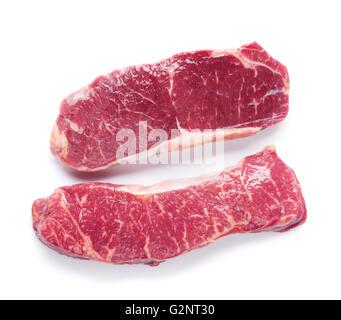 Raw striploin steak. Isolated on white background - Stock Photo
