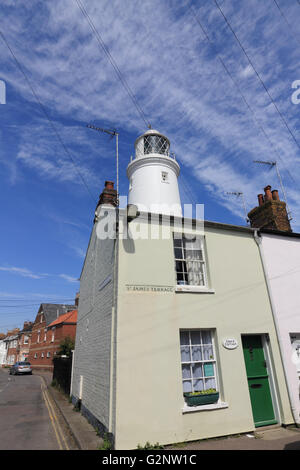 Pretty terraced cottages on St James's Terrace and the lighthouse at Southwold Suffolk England UK - Stock Photo