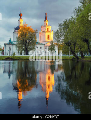 Ortodox church and its reflection in a pond. - Stock Photo