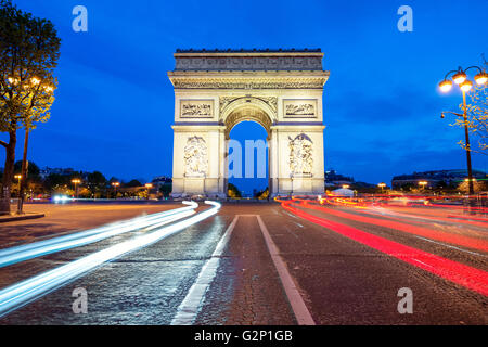 Arc de Triomphe at night in Paris, France - Stock Photo