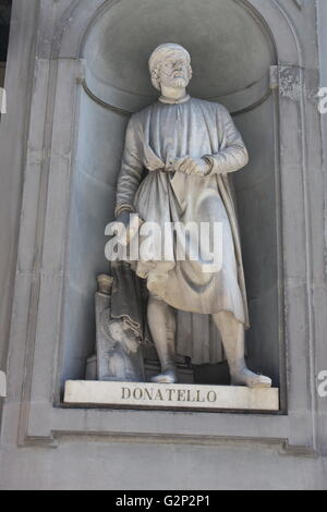 Statue located outside of the Uffizi museum in Florence, Italy. One of the oldest art museums in the Western World. - Stock Photo