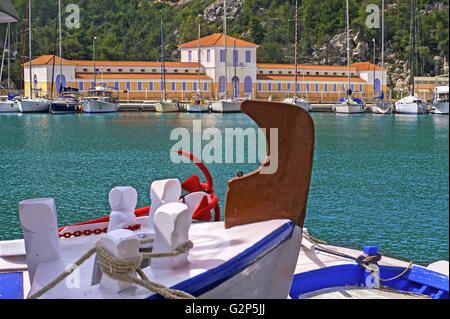 View to the port of Methana thermal resort and the spa building situated in the Saronic gulf, nearby Piraeus, Greece - Stock Photo